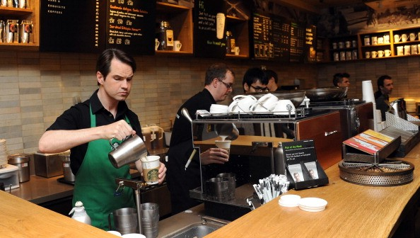 LONDON, UNITED KINGDOM - MARCH 14: Jimmy Carr (L) launches new stronger British Latte  at Starbucks on March 14, 2012 in London, England. (Photo by Stuart Wilson/Getty Images)