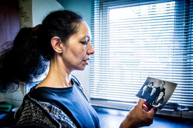 Laura Tansley holding a photograph of her great-grandmother, who came to North Kensington in the 1930s with her family to look for work. (BBC)