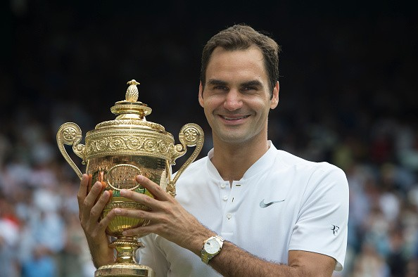 LONDON, ENGLAND - JULY 16: Roger Federer of Switzerland poses for photographs as he celebrates winning the Men's Singles Final against Marin Cilic on day thirteen of the Wimbledon Lawn Tennis Championships at the All England Lawn Tennis and Croquet Club  on July 16, 2017 in London, England. (Photo by Visionhaus/Corbis via Getty Images)
