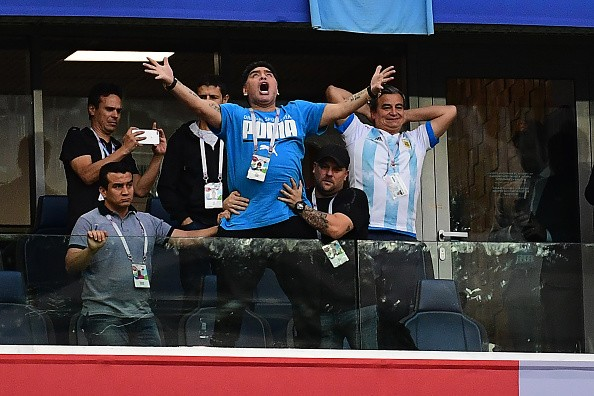 Former Argentina forward Diego Maradona (C) celebrates the opening goal during the Russia 2018 World Cup Group D football match between Nigeria and Argentina at the Saint Petersburg Stadium in Saint Petersburg on June 26, 2018. (Photo by Giuseppe CACACE / AFP) / RESTRICTED TO EDITORIAL USE - NO MOBILE PUSH ALERTS/DOWNLOADS        (Photo credit should read GIUSEPPE CACACE/AFP/Getty Images)