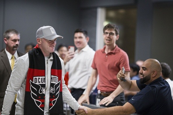 English soccer player Wayne Rooney arrives at Dulles International Airport on June 28, 2018 in Dulles, Virginia. - Rooney will join Major League Soccer's DC United and will debut with the team July 14, 2018. England record goalscorer Wayne Rooney left boyhood club Everton for D.C. United of Major League Soccer on Thursday, saying he hungers for American success to fulfill a career goal. The US club and English Premier League outfit announced the agreement on a permanent transfer as Rooney was on a flight to Washington. (Photo by ZACH GIBSON / AFP)        (Photo credit should read ZACH GIBSON/AFP/Getty Images)