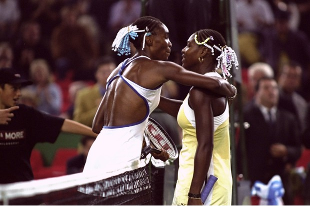 3 Oct 1999: Venus Williams of the USA congratulates sister Serena on winning the Grand Slam Cup at the Olympiahalle in Munich, Germany. (Getty/ Clive Brunskill /Allsport)