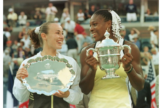 11 Sep 1999: Matina Hingis of Switzerland and Serena Williams exchange glances during the trophy presentation after the singles final during the semifinals of the US Open at the USTA National Tennis Center in Flushing Meadows, New York. (Getty/Jamie Squire/ALLSPORT)