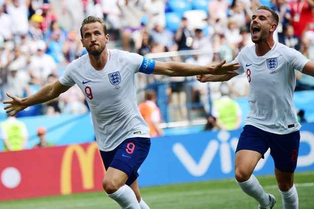 England's forward Harry Kane celebrates with England's midfielder Jordan Henderson (R) after scoring a penalty during the Russia 2018 World Cup Group G football match between England and Panama at the Nizhny Novgorod Stadium in Nizhny Novgorod on June 24, 2018. (Photo by Martin BERNETTI / AFP) / RESTRICTED TO EDITORIAL USE - NO MOBILE PUSH ALERTS/DOWNLOADS        (Photo credit should read MARTIN BERNETTI/AFP/Getty Images) Getty, TL