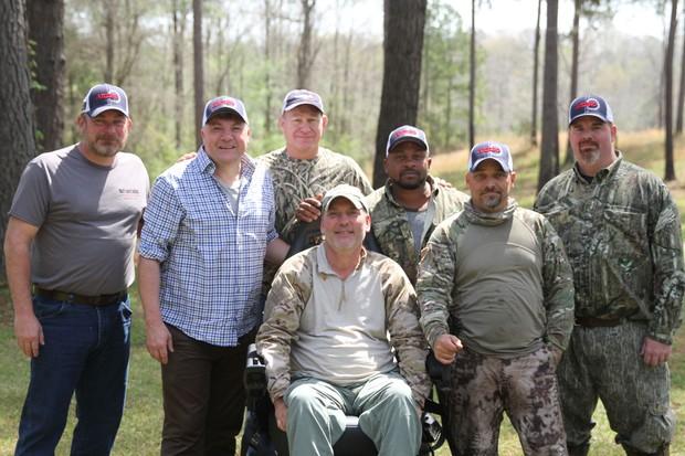 (2nd L) with AHERO farm army veterans. Ed Balls - (C) (BBC)