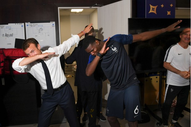 French President Emmanuel Macron dabs with Paul Pogba during the 2018 FIFA World Cup Russia Final between France and Croatia at Luzhniki Stadium on July 15, 2018 in Moscow, Russia. (Photo by Michael Regan - FIFA/FIFA via Getty Images)