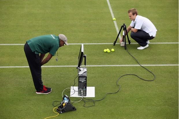 WIMBLEDON, ENGLAND - JUNE 18: Hawk-Eye technicians check their ball detection systems on Courts No.3 at the All England Lawn Tennis and Croquet Club ahead of the Wimbledon Lawn Tennis Championships on June 18, 2011 in London, England. The Championships which are celebrating their 125th anniversary this year begin on June 20, 2011. (Photo by Oli Scarff/Getty Images) TL