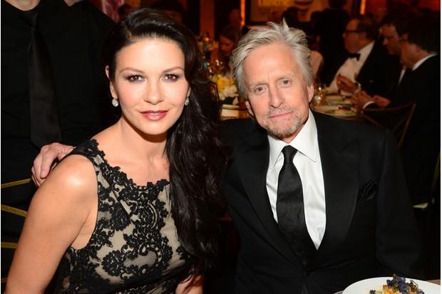 Douglas with wife Catherine Zeta-Jones (Getty, TL)