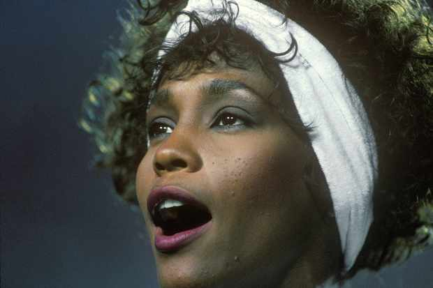 TAMPA, FL - 1991:  Singer and actress Whitney Houston sings the National Anthem at the 1991 Tampa, Florida, Superbowl XXV. Houston's rendition of the National Anthem was particularly inspiring due to the fact that Superbowl XXV (25) was held as the first Gulf War began.(Photo by George Rose/Getty Images)