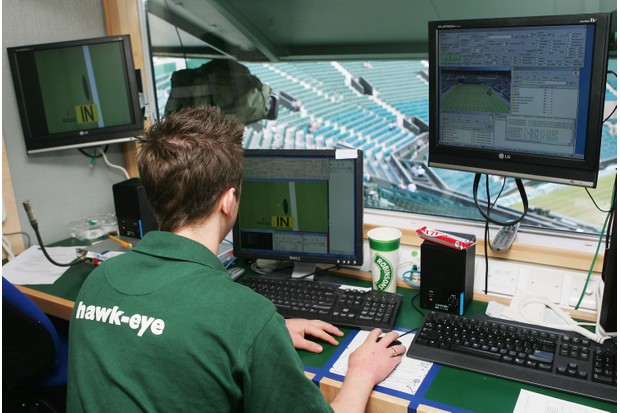 """LONDON - JULY 08: A technician prepares the """"Hawkeye"""" sytem prior to play during day thirteen of the Wimbledon Lawn Tennis Championships at the All England Lawn Tennis and Croquet Club on July 8, 2007 in London, England. (Photo by Julian Finney/Getty Images) TL"""