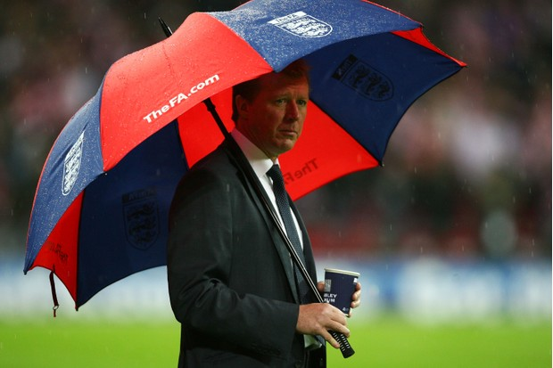 """Steve McClaren was dubbed """"The wally with the brolly"""" after the loss (Getty, TL)"""