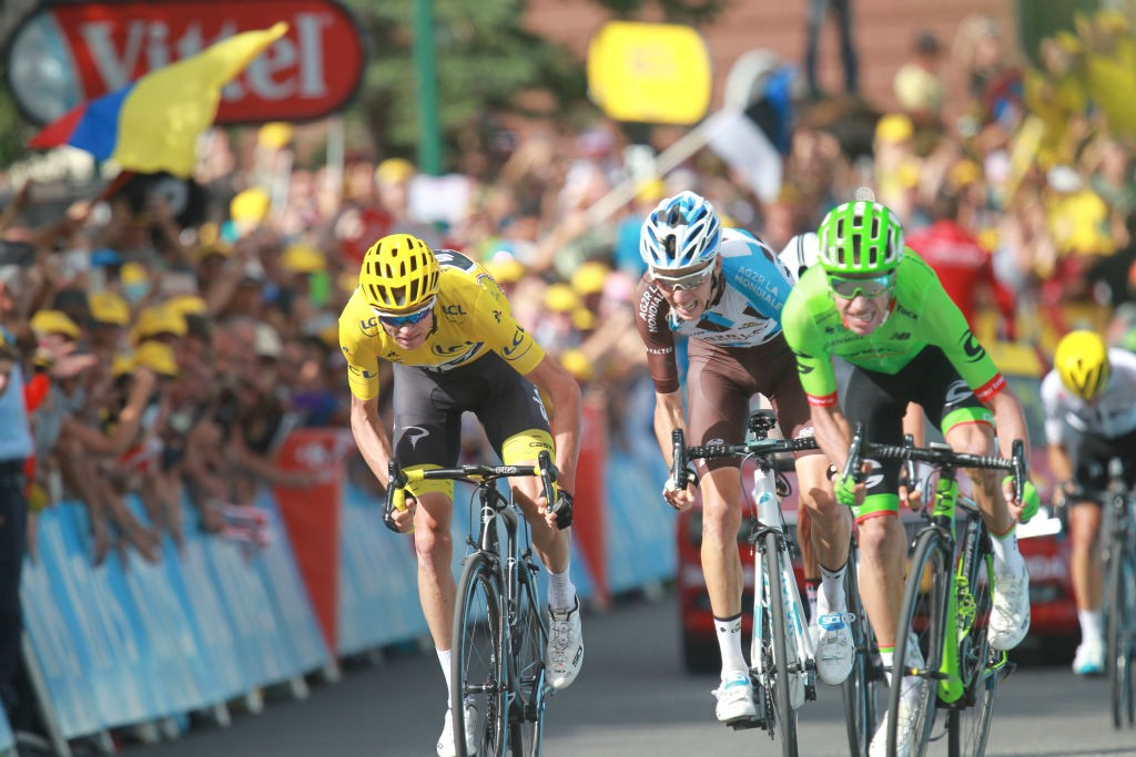 (From L) Great Britain's Christopher Froome wearing the overall leader's yellow jersey, France's Romain Bardet and Colombia's Rigoberto Uran ride towards the finish line during the 183 km seventeenth stage of the 104th edition of the Tour de France cycling race on July 19, 2017 between Le La Mure and Serre-Chevalier, French Alps.  (Photo by Elyxandro Cegarra/NurPhoto via Getty Images)
