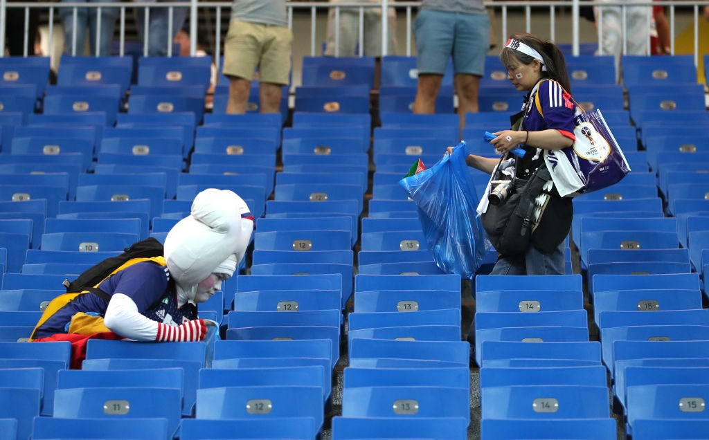 ROSTOV-ON-DON, RUSSIA - JULY 02:  Japan fans collect rubbish from the stands following their sides defeat in the 2018 FIFA World Cup Russia Round of 16 match between Belgium and Japan at Rostov Arena on July 2, 2018 in Rostov-on-Don, Russia.  (Photo by Catherine Ivill/Getty Images)