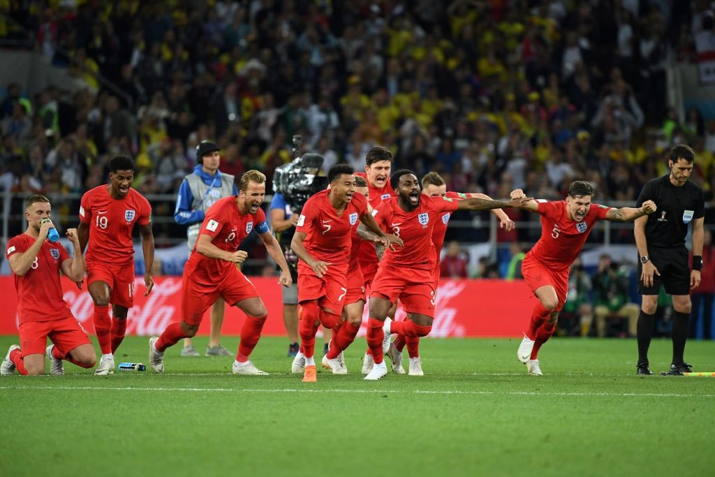 TOPSHOT - England's players celebrate winning the penalty shootout at the end of the Russia 2018 World Cup round of 16 football match between Colombia and England at the Spartak Stadium in Moscow on July 3, 2018. (Photo by YURI CORTEZ / AFP) / RESTRICTED TO EDITORIAL USE - NO MOBILE PUSH ALERTS/DOWNLOADS        (Photo credit should read YURI CORTEZ/AFP/Getty Images)