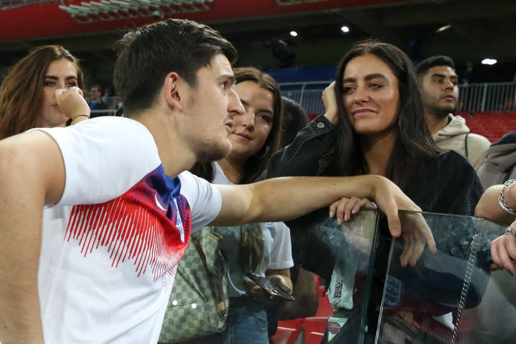 MOSCOW, RUSSIA - JULY 3: Harry Maguire of England and his girlfriend Fern Hawkins following the 2018 FIFA World Cup Russia Round of 16 match between Colombia and England at Spartak Stadium on July 3, 2018 in Moscow, Russia. (Photo by Jean Catuffe/Getty Images)