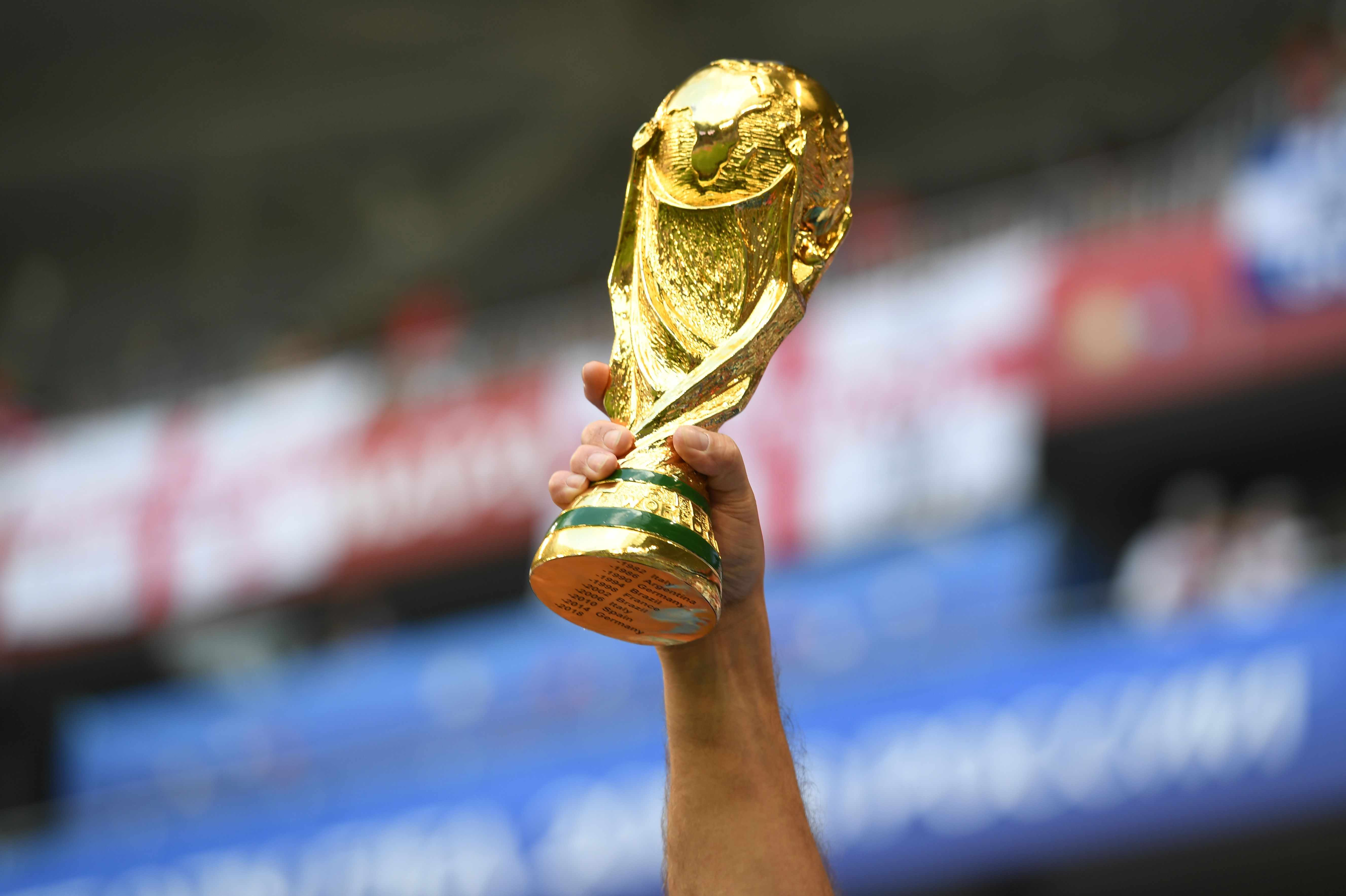 An England fan rises a replica of the World Cup trophy before the Russia 2018 World Cup quarter-final football match between Sweden and England at the Samara Arena in Samara on July 7, 2018. (Photo by YURI CORTEZ / AFP) / RESTRICTED TO EDITORIAL USE - NO MOBILE PUSH ALERTS/DOWNLOADS        (Photo credit should read YURI CORTEZ/AFP/Getty Images)  TL