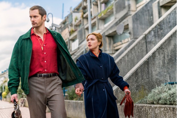 Alexander Skarsgård as Becker, Florence Pugh as Charlie Ross - The Little Drumer Girl _ Season 1, Episode 3 - Photo Credit: © 2018 The Little Drummer Girl Distribution Limited. All rights reserved. TL, BBC