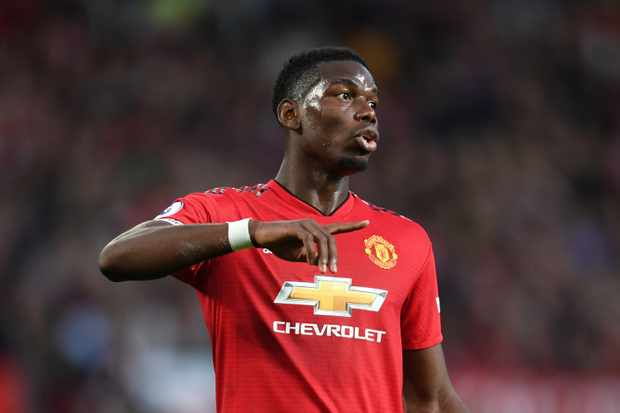 MANCHESTER, ENGLAND - AUGUST 10:  Paul Pogba of Manchester United reacts during the Premier League match between Manchester United and Leicester City at Old Trafford on August 10, 2018 in Manchester, United Kingdom.  (Photo by Michael Regan/Getty Images)TL