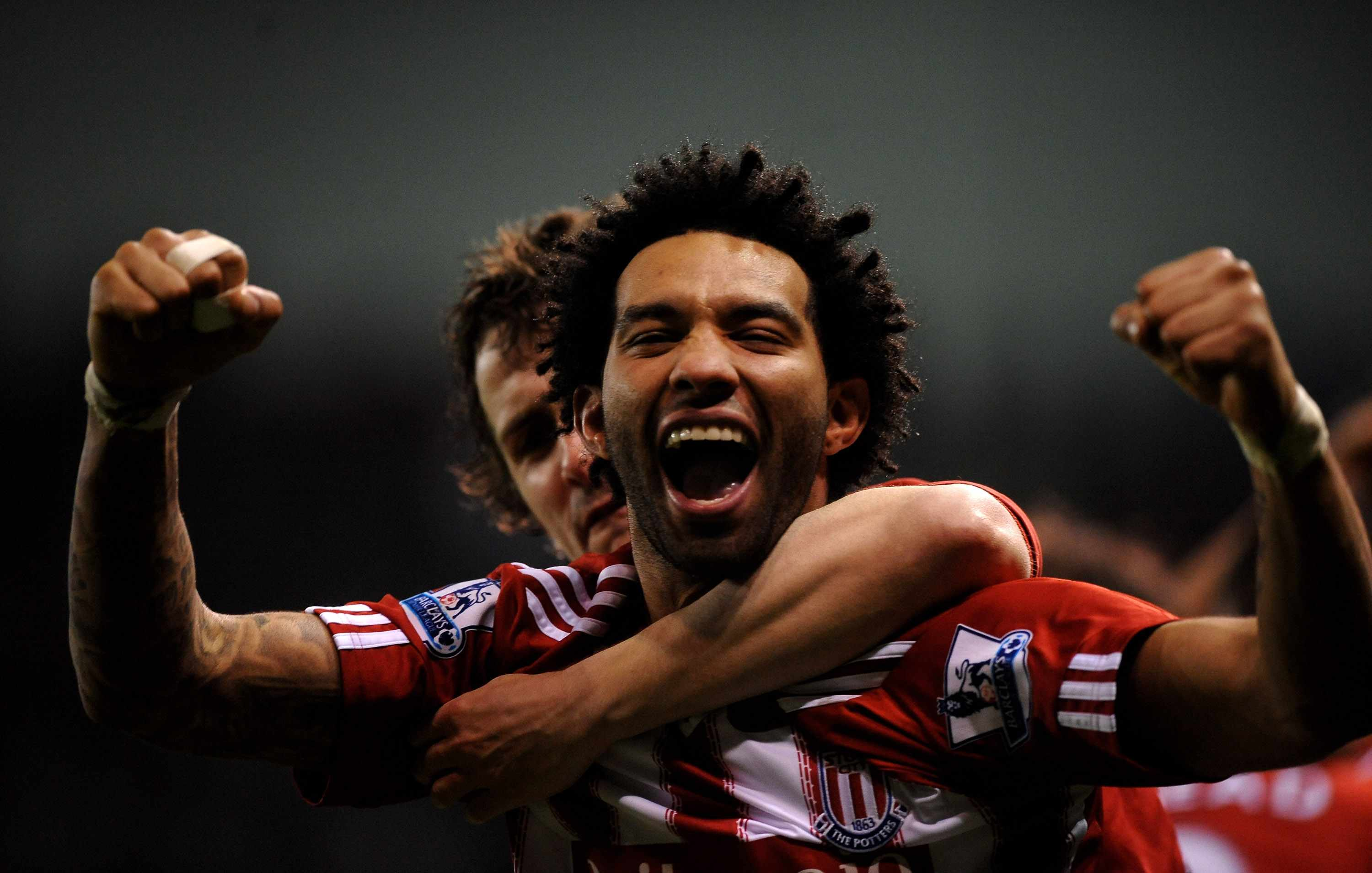 STOKE ON TRENT, ENGLAND - FEBRUARY 28:  Jermaine Pennant of Stoke City celebrates after team mate Rory Delap scored the opening goal during the Barclays Premier League match between Stoke City and West Bromwich Albion at The Britannia Stadium on February 28, 2011 in Stoke on Trent, England.  (Photo by Laurence Griffiths/Getty Images)