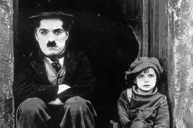 Charlie Chaplin acting with the young Jackie Coogan in The Kid, 1921