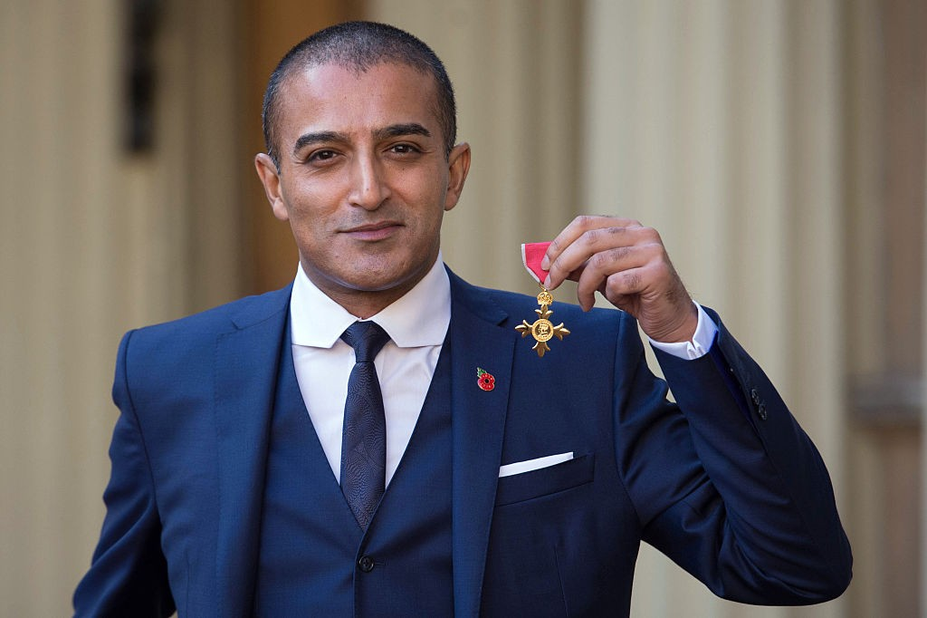 LONDON, ENGLAND - NOVEMBER 11:  Actor and writer Adil Ray with his OBE which he received  from the Duke of Cambridge at Buckingham Palace on November 11, 2016 in London, England. (Photo by Stefan Rousseau - WPA Pool/Getty Images)