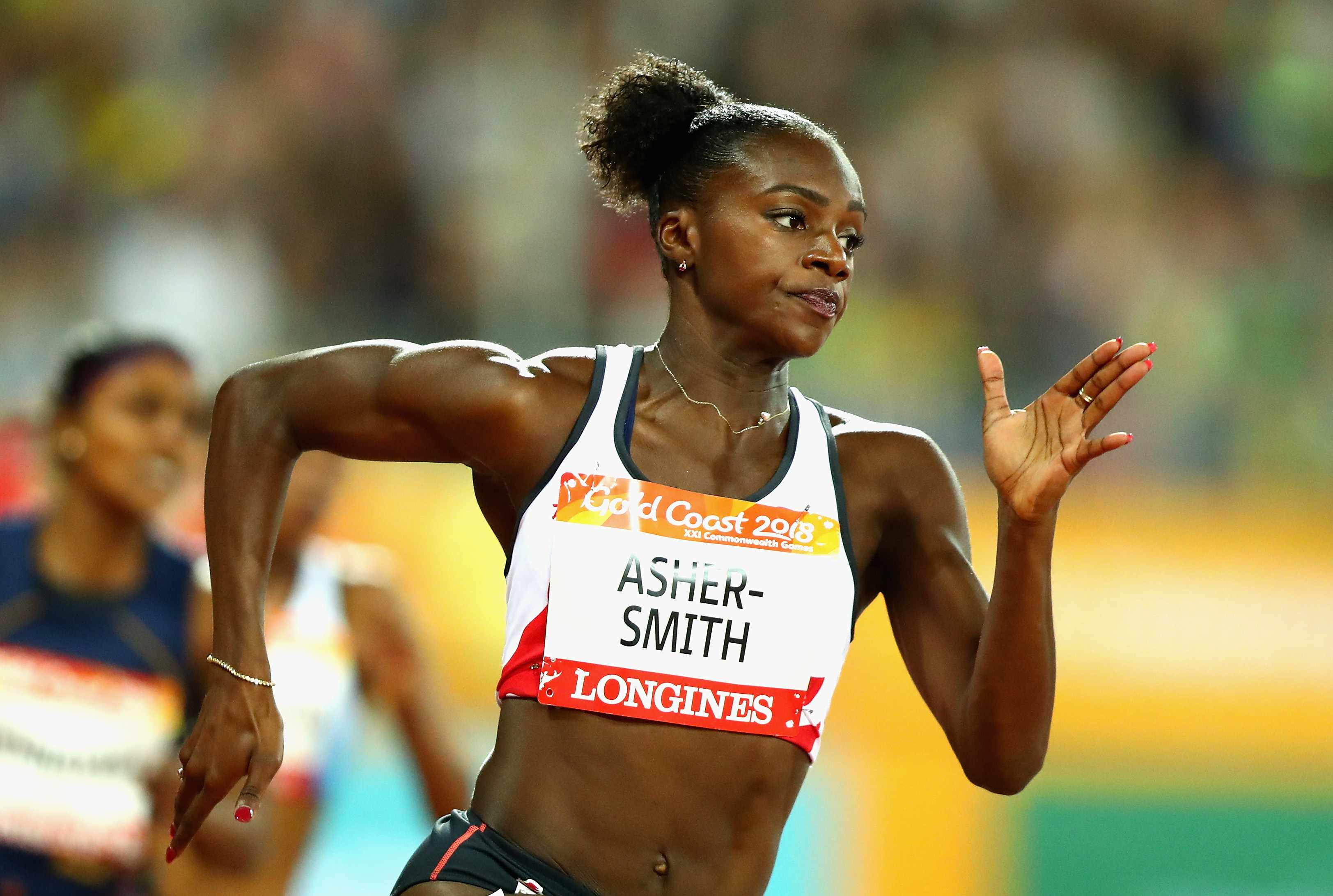 GOLD COAST, AUSTRALIA - APRIL 11:  Dina Asher-Smith of England competes in the Women's 200 metres semi finals during athletics on day seven of the Gold Coast 2018 Commonwealth Games at Carrara Stadium on April 11, 2018 on the Gold Coast, Australia.  (Photo by Dean Mouhtaropoulos/Getty Images)  TL