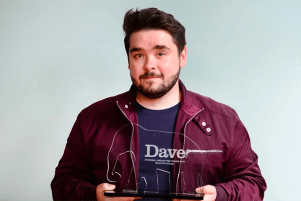 Adam Rowe with his Dave award for best one-liner at the Edinburgh Fringe Festival (UKTV, HF)
