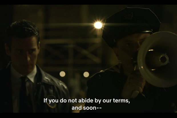 An example of a dark scene in Netflix's Mindhunter where subtitles are necessary