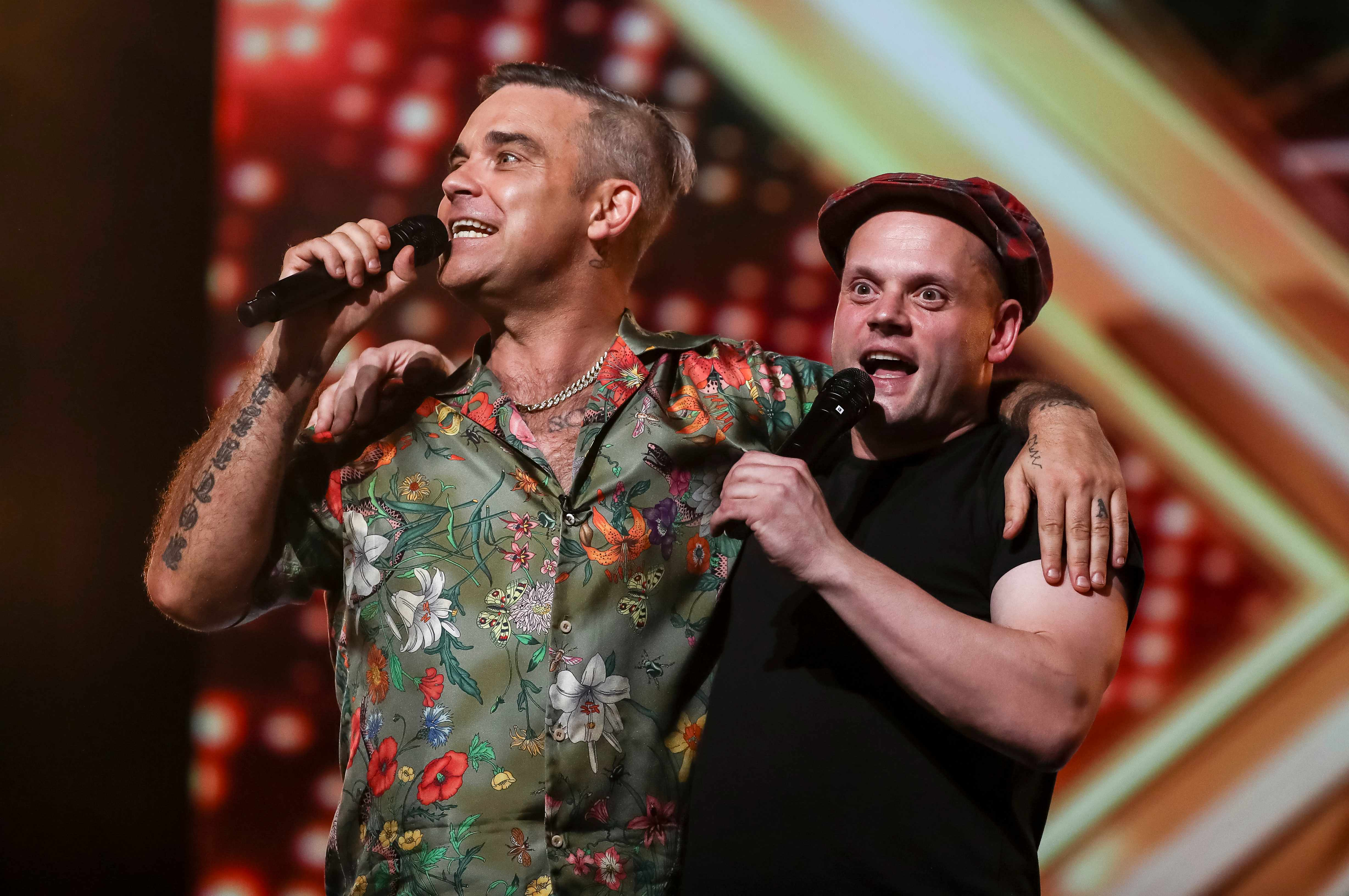 Robbie Williams and X factor act Andy Hoften ©Thames/Syco