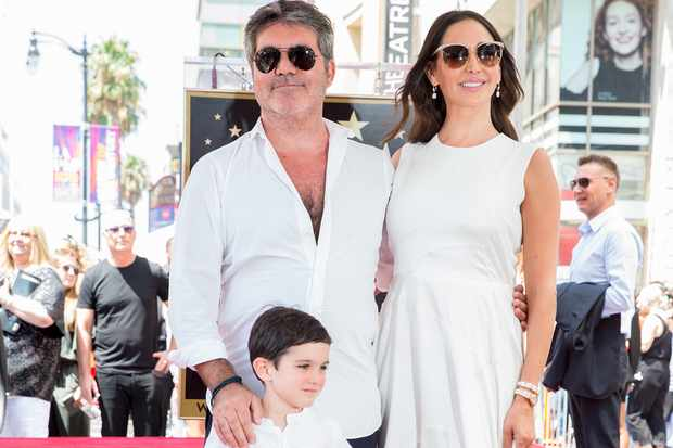 Simon Cowell, Lauren Silverman and Eric Cowell attend Simon's 2018 Hollywood Walk of Fame Ceremony (Getty)