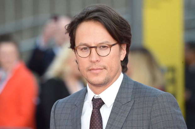 """US director Cary Joji Fukunaga poses on the red carpet upon arrival for the world premiere of the film """"Maniac"""" in central London on September 13, 2018. (Photo by Anthony HARVEY / AFP) (Photo credit should read ANTHONY HARVEY/AFP/Getty Images)"""