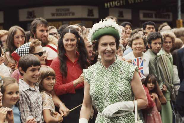 Queen Elizabeth II meets the crowds during her royal tour of New Zealand, 1977. (Photo by Serge Lemoine/Getty Images)