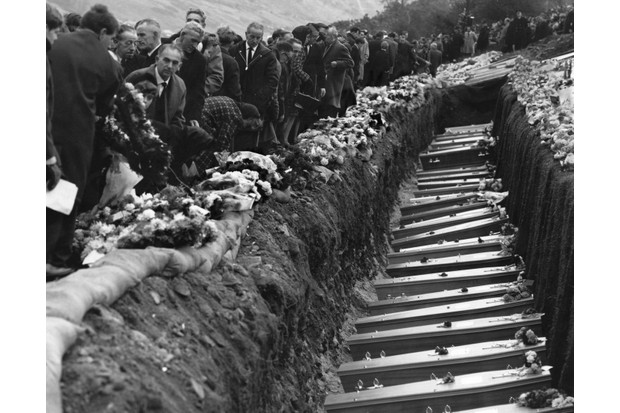 Inhabitants of the Welsh mining village of Aberfan attend the mass funeral for 81 of the 190 children and adults who perished when a landslide engulfed the junior school. (Photo by George Freston/Getty Images)