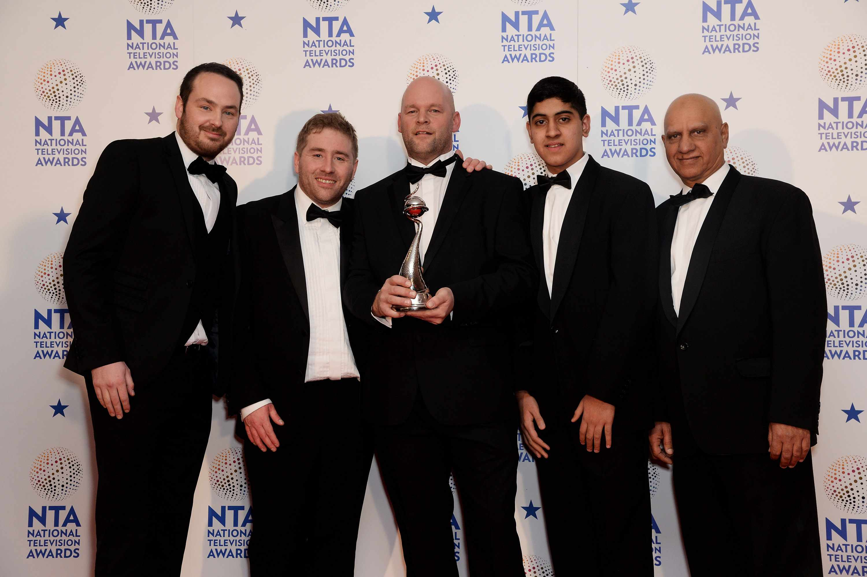 LONDON, ENGLAND - JANUARY 22: Jonny Mitchell, Matthew Burton, Michael Steer and Musharaf Asghar pose with their Best Documentary Series award for 'Educating Yorkshire' in front of the winners boards at the National Television Awards 2014 on January 22, 2014 in London, England. (Photo by Dave J Hogan/Getty Images)
