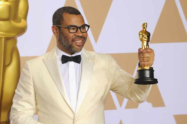 HOLLYWOOD, CA - MARCH 04:  Writer Jordan Peele, winner of the Best Original Screenplay award for 'Get Out,'  poses inside the Press Room of the 90th Annual Academy Awards held at Hollywood & Highland Center on March 4, 2018 in Hollywood, California.  (Photo by Albert L. Ortega/WireImage)
