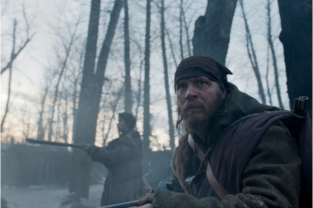 (L-R): Will Poulter as Jim Bridger and Tom Hardy as John Fitzgerald in THE REVENANT. (Twentieth Century Fox)