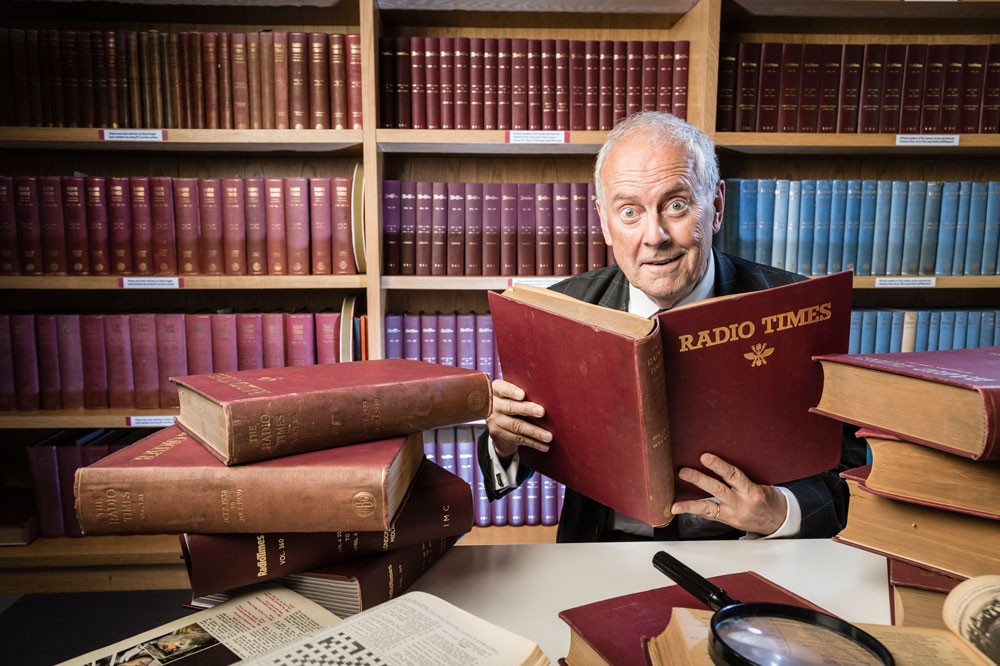 Gyles Brandreth in heaven, surrounded by bound volumes of past issues of Radio Times (RT)