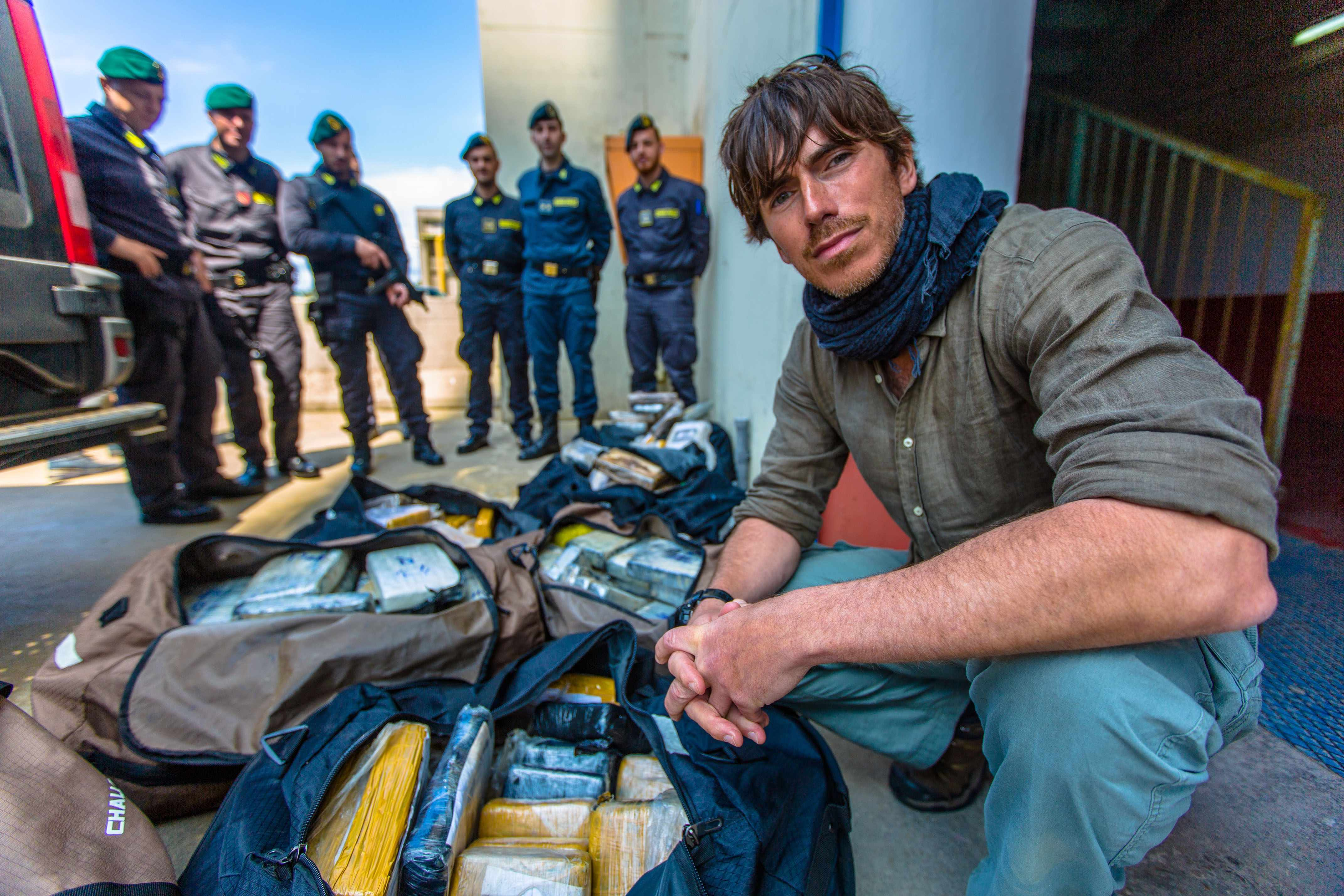 Programme Name: The Mediterranean with Simon Reeve - TX: n/a - Episode: n/a (No. 1) - Picture Shows: with Italy's anti-smuggling police and over a tonne of cocaine confiscated from the Mafia, worth an estimated two hundred million pounds.  Simon Reeve - (C) BBC - Photographer: Craig Hastings