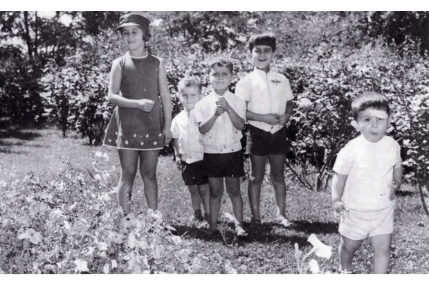 The al-Assad children in a garden, 1970s, (l-r) Bushra, Majd, Bashar, Bassel and Maher. (BBC)