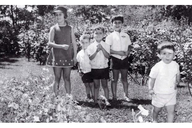 The al-Assad children in a garden, 1970s, (l-r) Bushra, Majd, Bashar, Bassel and Maher. (BBC)