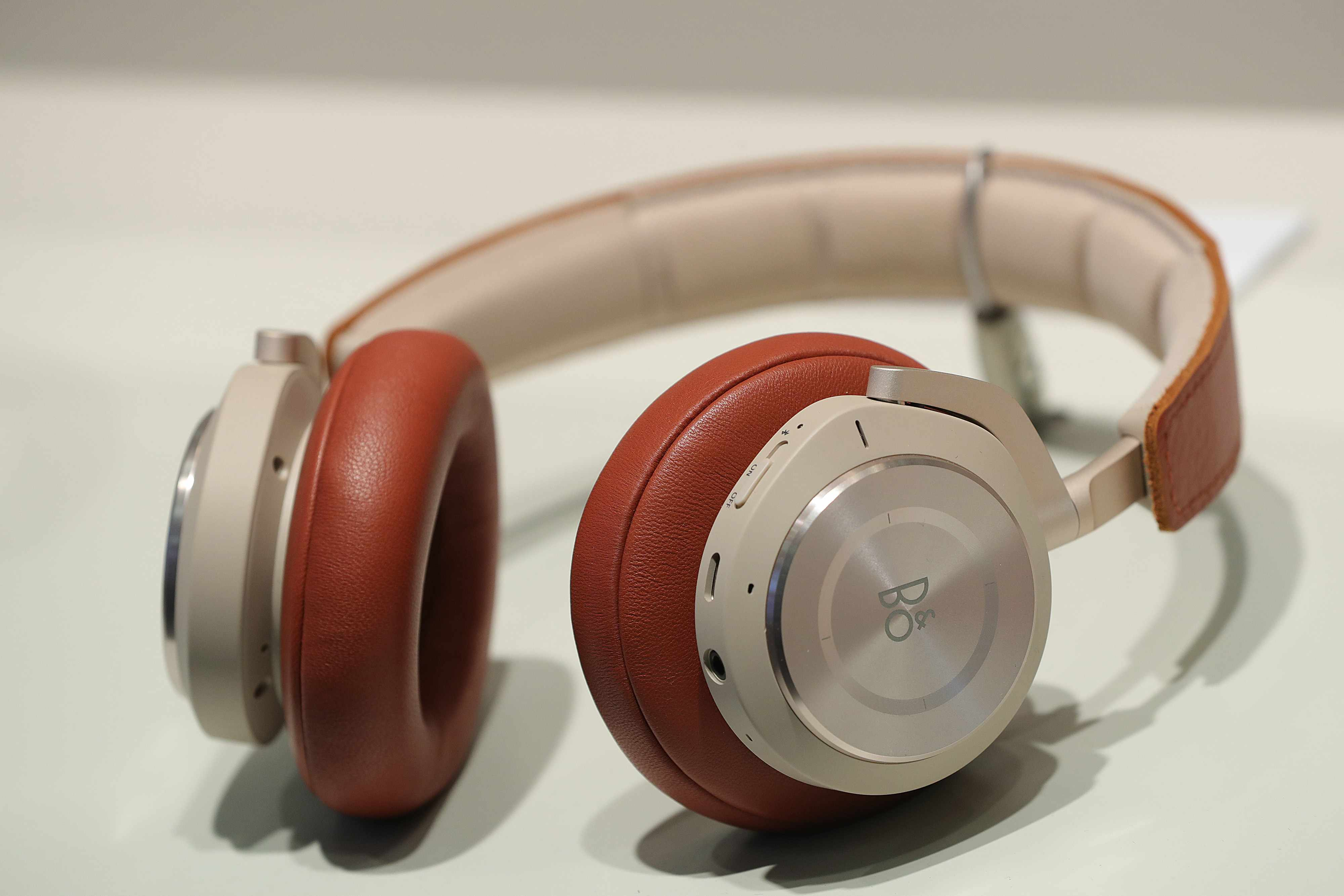 A pair of Beoplay H9i headphones sit on the Bang & Olufsen A/S exhibition stand during a press preview day at the IFA consumer electronics show in Berlin, Germany, on Thursday, Aug. 30, 2018. IFA, which runs Aug. 31 to Sept. 5, showcases the latest digital lifestyle products and technology. Photographer: Krisztian Bocsi/Bloomberg via Getty Images