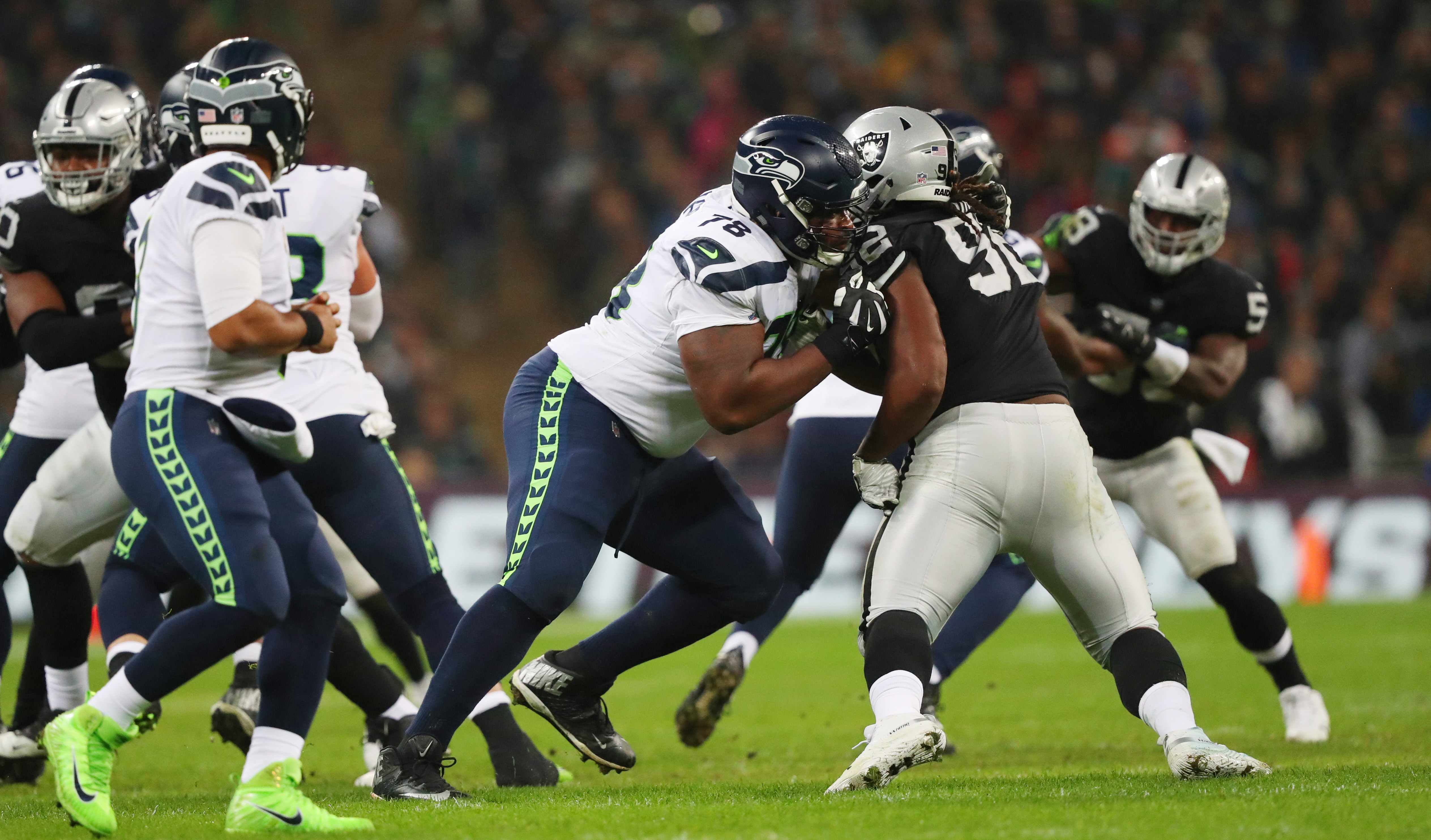 LONDON, ENGLAND - OCTOBER 14: Offensive guard D.J. Fluker #78 of the Seattle Seahawks blocks nose tackle P.J. Hall #92 of the Oakland Raiders at Wembley Stadium on October 14, 2018 in London, United Kingdom.  (Photo by Mitchell Gunn/Getty Images)  TL
