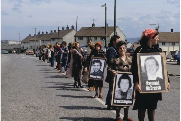 In Belfast, Northern Ireland, demonstrators carrying portraits, hold a silent vigil for the Irish Republican Army (IRA) hunger-striker, Bobby Sands, who died in the British-run Maze Prison.