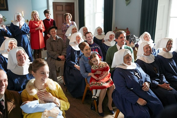 Programme Name: Call the Midwife S8 - TX: n/a - Episode: Call the Midwife S8 - Iconics (No. n/a) - Picture Shows: Back row: Helen George (Trixie Franklin), Jennifer Kirby (Valerie Dyer), Annabelle Apsion (Violet Buckle) In front: (grey coat) Georgie Glen (Miss Higgins) In front: Fenella Woolgar (Sister Hilda), Daniel Laurie (Reggie) In front: Laura Main (Shelagh Turner), Stephen McGann (Dr. Turner), Max Macmillan (Timothy Turner) In front: Miriam Margolyes (Sister Mildred), Jenny Agutter (Sister Julienne) - (C) Neal Street - Photographer: Nicky Johnston TL