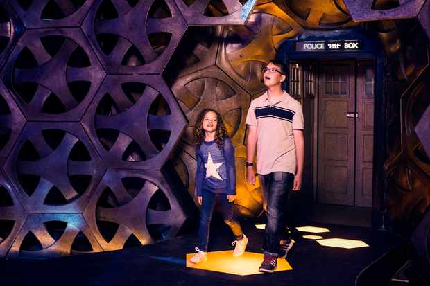 Anna and Alex enter the Tardis (C) BBC - Photographer: Sophie Mutevelian