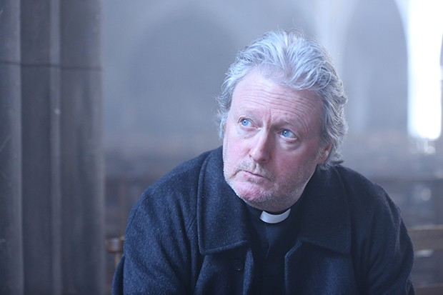 Charles Lawson plays Father Connolly in Dark Heart
