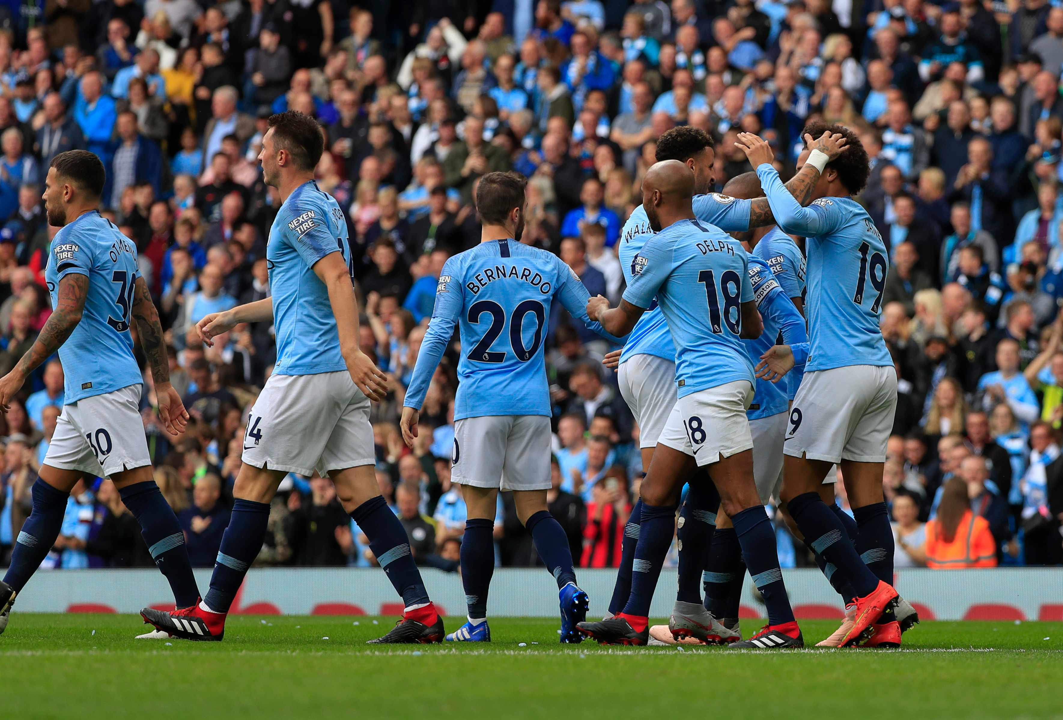15th September 2018, Etihad Stadium, Manchester, England; EPL Premier League football, Manchester City versus Fulham; City players congratulate Leroy Sane on scoring the opening goal in the 2nd minute, 1-0 to City (photo by Conor Molloy/Action Plus via Getty Images)