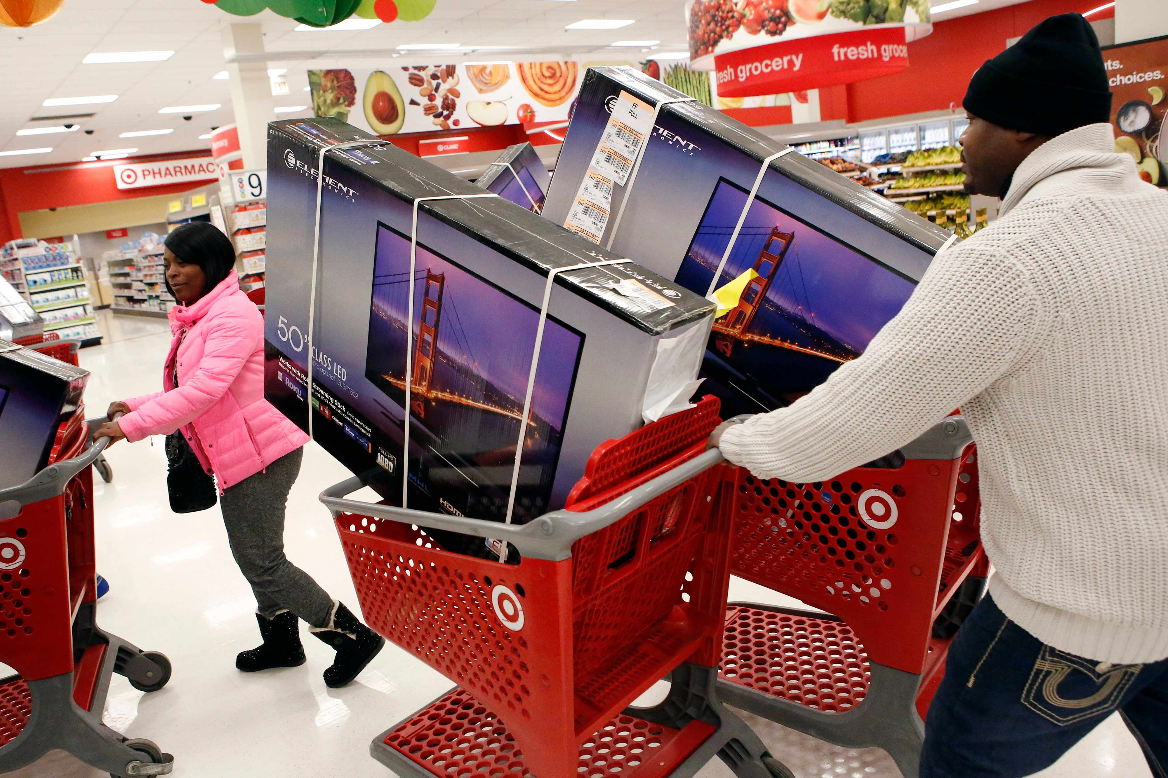 Customers pick up shopping carts containing Element Electronics 50-inch light-emitting diode (LED) high definition televisions at a Target Corp. store opening ahead of Black Friday in Chicago, Illinois, U.S., on Thursday, Nov. 28, 2013. U.S. retailers will kick off holiday shopping earlier than ever this year as stores prepare to sell some discounted items at a loss in a battle for consumers. Photographer: Patrick T. Fallon/Bloomberg via Getty Images  TL, Getty
