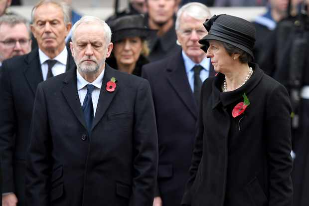 LONDON, ENGLAND - NOVEMBER 12:  Jeremy Corbyn and Theresa May during the annual Remembrance Sunday Service at The Cenotaph on November 12, 2017 in London, England.  (Photo by Karwai Tang/WireImage)