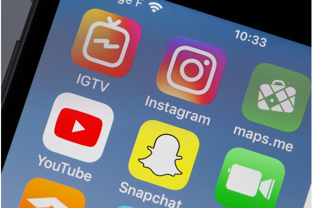 PARIS, FRANCE - JUNE 22: In this photo illustration, the logos of the IGTV, Instagram, maps.me, Youtube and Snapchat applications are displayed on the screen of an Apple iPhone on June 22, 2018 in Paris, France. Instagram has launched Wednesday IGTV, a new application allowing users to publish videos in excess of 60 seconds today allowed. With one billion users now, Instagram is taking advantage of its success with a young audience eager to share photos and videos, to compete with the YouTube video platform. (Photo Illustration by Chesnot/Getty Images)